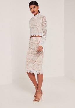 Beżowa spódnica midi z białym ozdobnym haftem