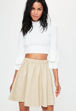 Mini-jupe évasée blanc crème en simili cuir