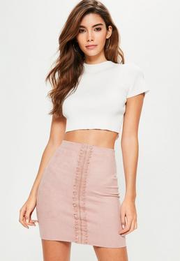 Mini-jupe rose en suédine détail dentelle