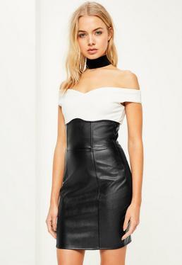 Mini-jupe noire en simili cuir taille super haute