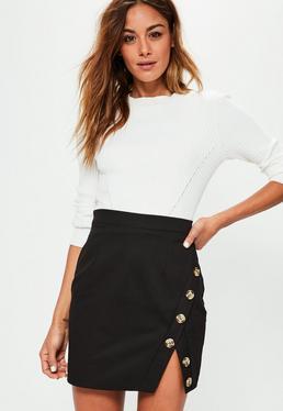 Mini-jupe noire asymétrique en coton avec détails boutons