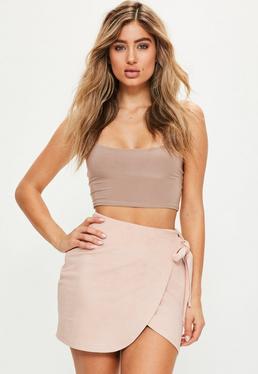 Różowa asymetryczna zamszowa spódniczka mini wiązana po boku