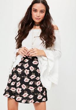Mini jupe noire en crêpe à imprimé fleuri