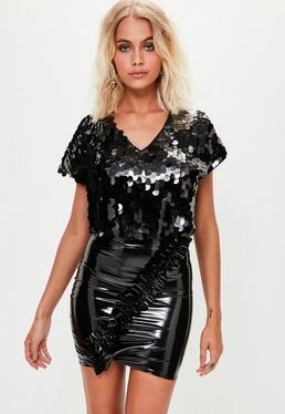 Mini-jupe asymétrique noire en vinyle