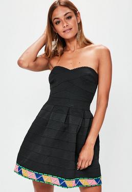 Czarna bandażowa rozkloszowana sukienka ze zdobieniami