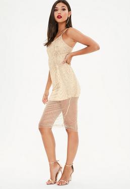 Złota cekinowa sukienka midi