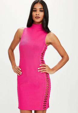 Różowa bandażowa sukienka z wycięciami po bokach
