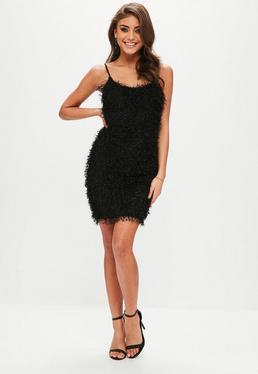 Vestido corto de flecos en negro