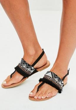 Sandalias con flecos en negro