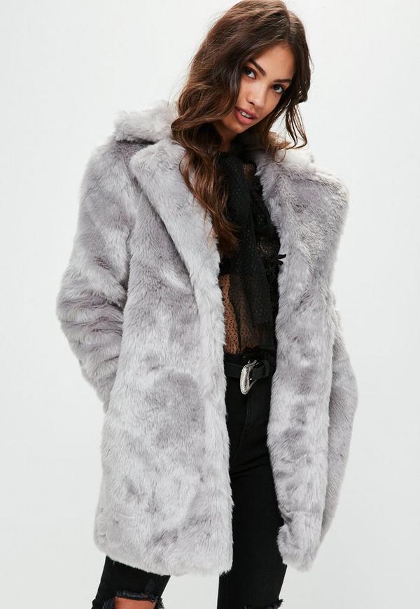 370157f05e3 ... Manteau gris en fausse fourrure. Précédent Suivant