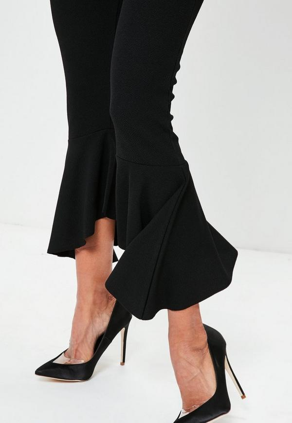 These flare-leg dress pants from Stazino are a classic shape and style to add to your wardrobe. The pants feature a flattering banded waist with belt loops and a button closure. Color: Black.