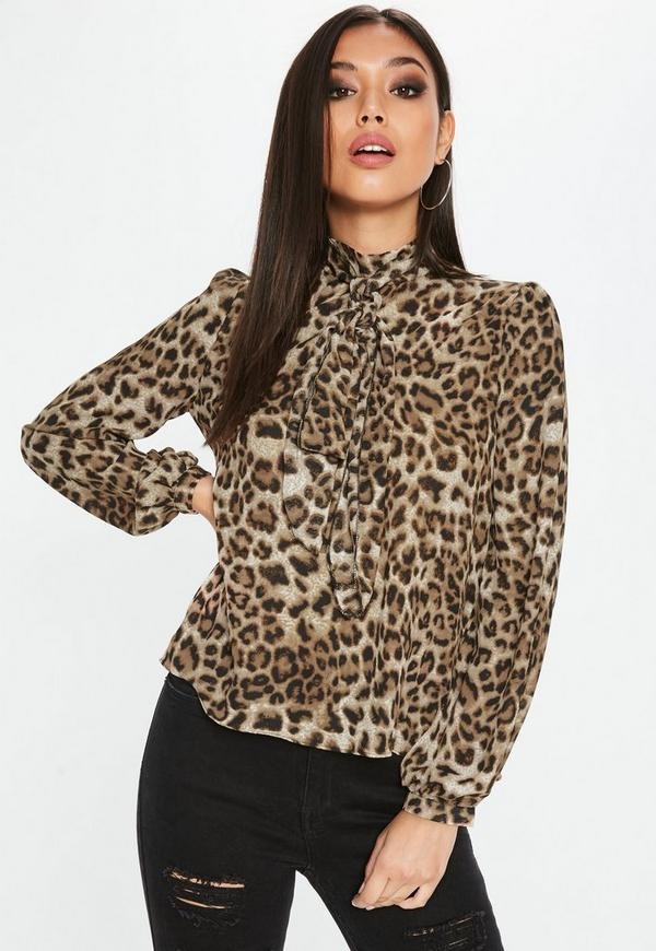 Travelers Collection By Chico's Blouse. black with gray animal print. zipper front. % polyester (hand wash). across the chest: 22