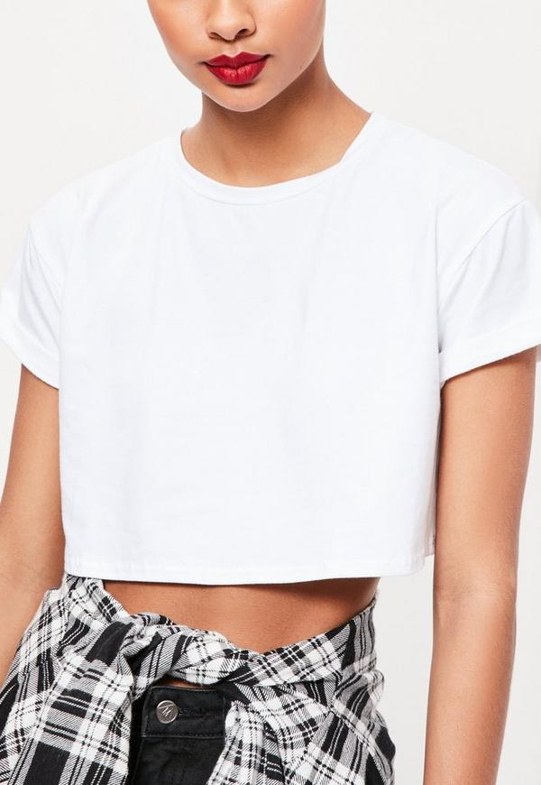 designer crop tops Show some skin-baring style with pieces from our collection of women's crop tops from favorite designers in a range of styles from casual to dressy. These tops pair beautifully with low-waisted or high-waisted bottoms for a coy glimpse or a flirty flash of skin.