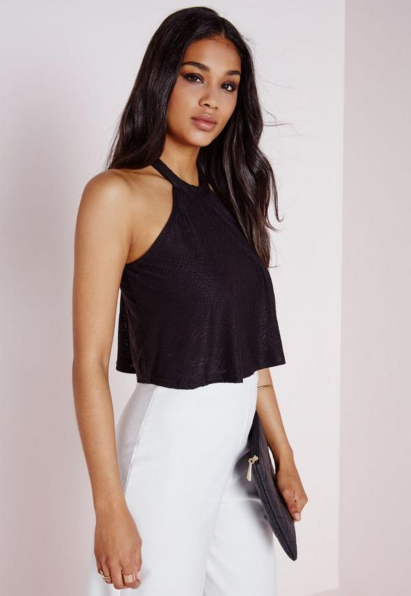 Let your body do the talking with this sexy crop top! It has a tie front bust paired with adjustable, elastic straps, and an extreme cropped fit. The garment is composed of a basic knit that offers a slim fit without compromising stretch. Don't forget to purchase the matching mini skirt! Model is 5'7 with a 32