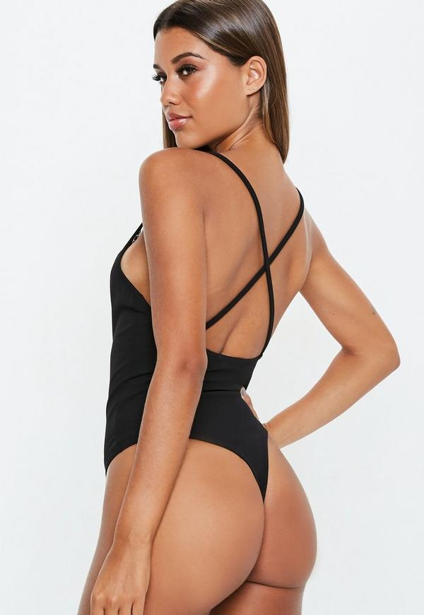 Sexy Bodysuits. There's just something so alluring about bebe's form-fitting and silky blouse-style bodysuits for women. Featuring a fabulous selection of silhouettes, colors and styles, bebe offers perfect bodysuit looks to wear with skirts, sweaters and more, from sleek black bodysuits and long sleeve bodysuits to cutout styles to sexy bustier designs.