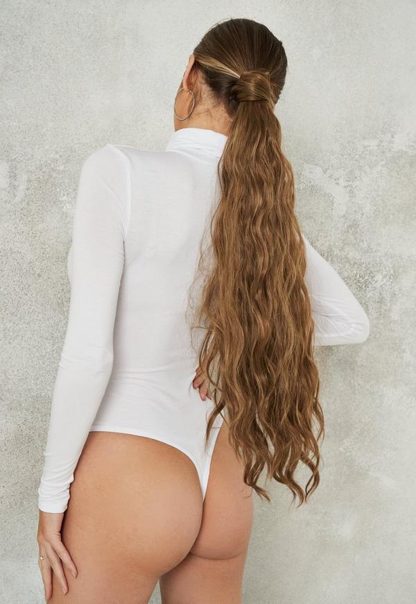 ... Body blanc à manches longues et col roulé. Précédent Suivant 013bf3a433f