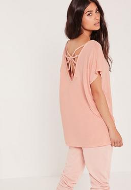 T-shirt rose détail bretelles reliées à un anneau au dos