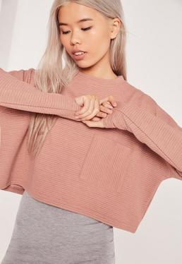 Różowa prążkowana krótka bluza z kieszonką