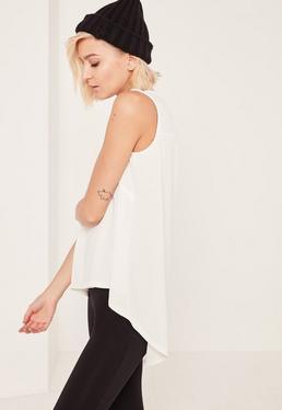 Biała bluzka z krepy z zaokraglonym długim tyłem