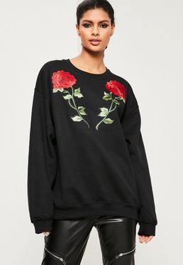 Sweat noir appliques fleuries roses