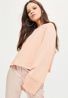 Różowa bluza z szerokimi rękawami