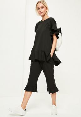 Oversize T-Shirt mit Rüschen-Schößchen Ärmeln und Peplum-Saum in Schwarz