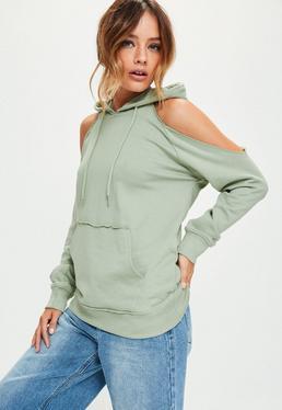 Zielona bluza z wyciętymi ramionami i kapturem
