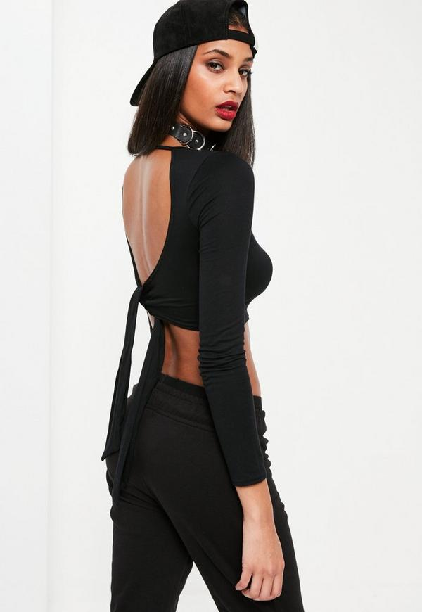 The classic long sleeve 90's crop top is back and better than ever with our strappy open back detail. Lace up back tie allow for the perfect comfort fit. Seamless neck line and tassel embellished straps modernize the classic hit.