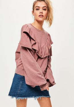 Różowa bluza z szerokimi rękawami i ozdobnymi falbanami