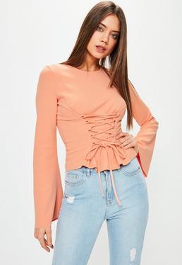 Top orange manches évasées détail corset