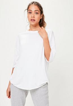 Camiseta oversize con detalles deshilachados en blanco