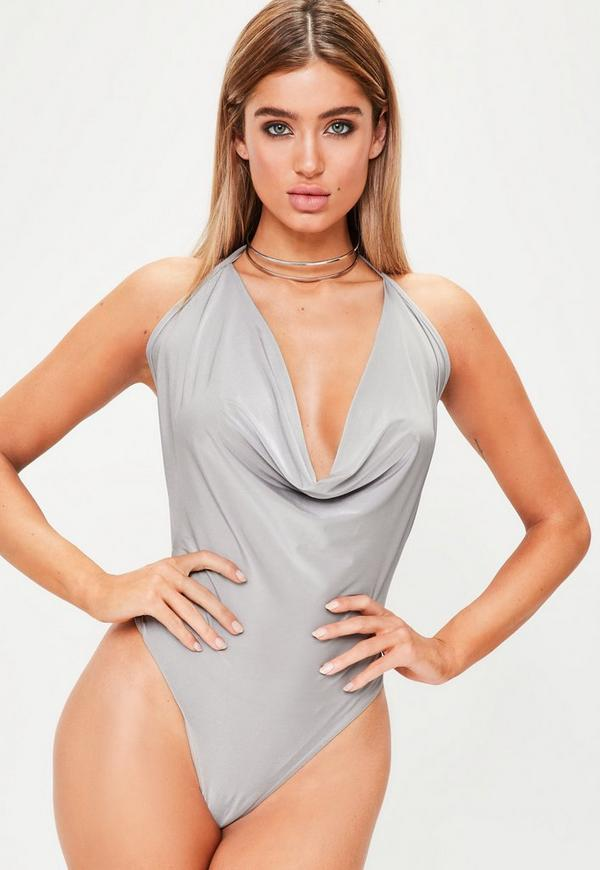 Pull me closer to you in the Take Hold Backless Bodysuit. An unforgettable bodysuit with a halter neck and straps that shows off your best assets: a bold collar bone, subtle shoulders, and sexy back. An everyday (or night) winner that spices up any bottom of your choice.