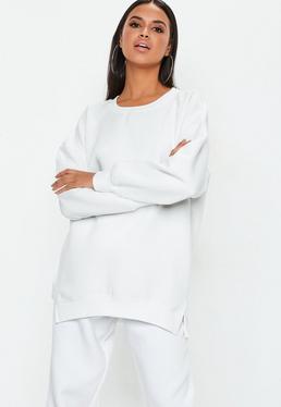 Biała owersajzowa bluza