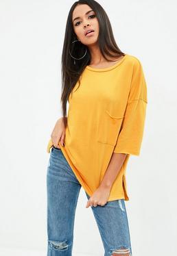 Żółta bluza z kieszonką z przodu