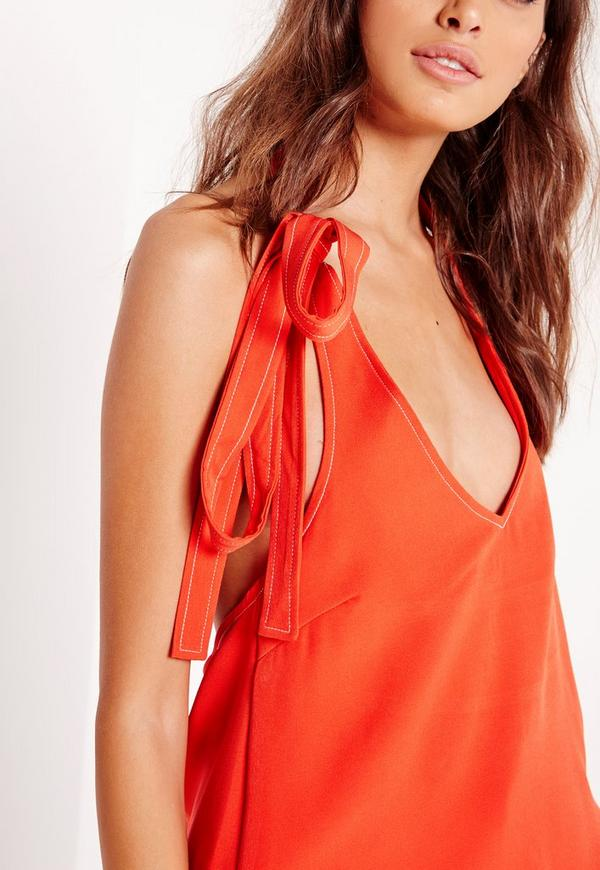 Ruffles and a lace-up detail adds a girlie touch to a flattering, lightweight babydoll cami.