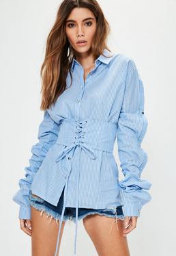 Niebieska owersajzowa koszula w paski z guzikami i gorsetowym wiązaniem