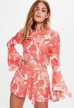 Pomarańczowa bluzka z szerokimi rękawami i wiązaniem na plecach w orientalne wzory