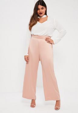 Różowe satynowe spodnie z luźnymi nogawkami Plus Size