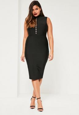 Czarna bandażowa sukienka z ozdobnymi zapięciami na dekolcie plus size