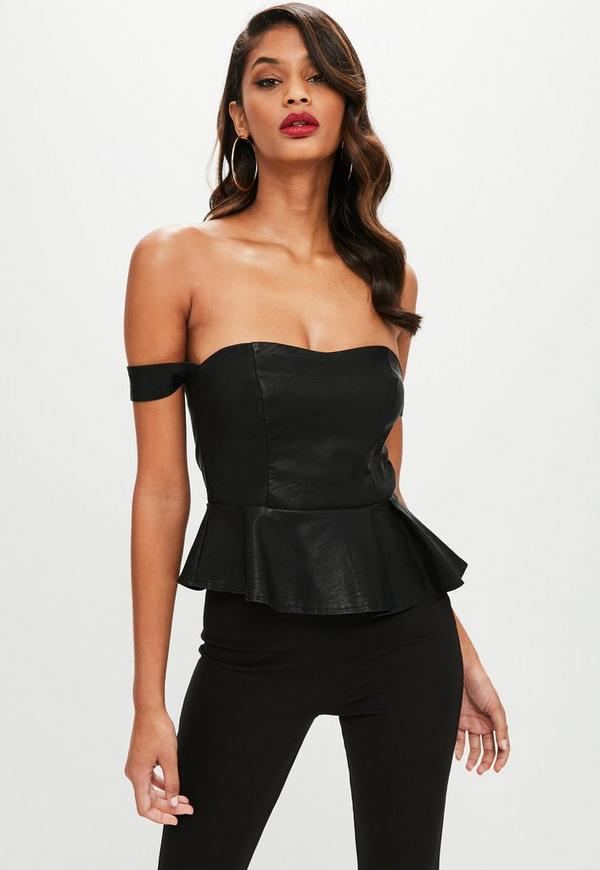 This ultra-sexy faux leather peplum top has platinum style details, a sexy lace up back, and is sure to turn heads. Wear with jeans or, if you feeling ultra sexy, wear by it self.