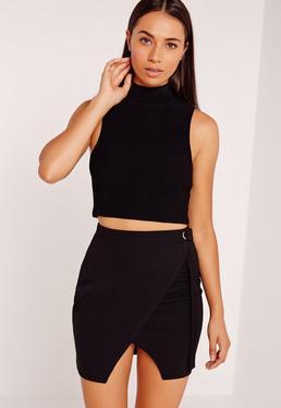 Mini-jupe portefeuille noire avec œillet Petite