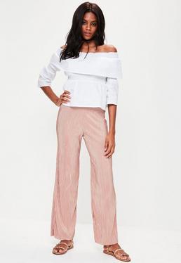 Pantalón petite de pierna ancha plisado en rosa