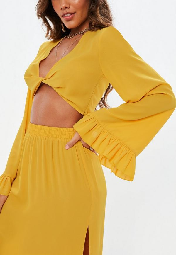 9bde0da9d545e5 Petite Mustard Yellow Twist Front Flared Sleeve Crop Top. Previous Next