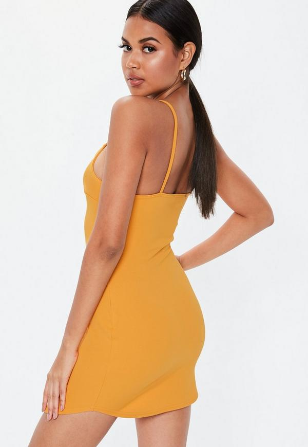 9b3a1996f97e ... Petite Mustard Strappy Plunge Bodycon Dress. Previous Next